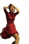 Woman in red dress holding her head and screaming